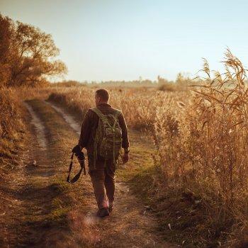 Hunter walking in field